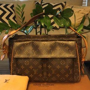 Authentic Louis Vuitton Cite w Dustbag